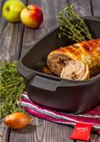 Baked duck roulade filled with meat stuffing and apples